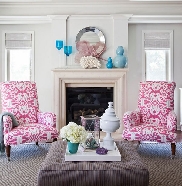 Pink Upholstery and turquoise accessories brighten the white backdrop