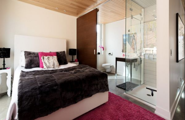 Plush rug and pillows in fashion fuchsia breathe life into a stylish modern bedroom