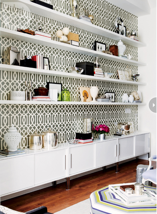 Shelving unit with black and white wallpaper backing