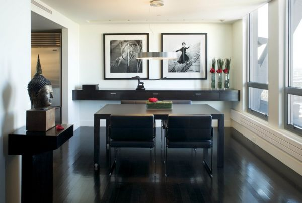 Sleek and stylish dining room with hints of red