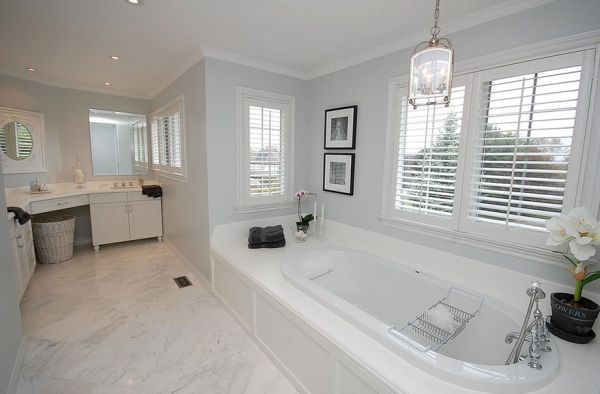 Spacious bathroom in gray and white promises opulence