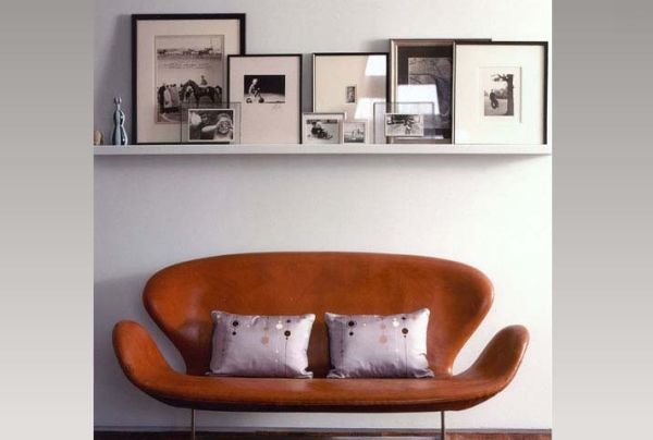 Stacked and leaning photographs exude a lovely casual vibe