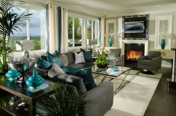 Stunning contemporary living room with exquisite use of turquoise accents