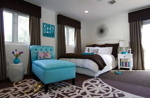 Stylish bedroom in white and chocolate brown with turquoise accent seat