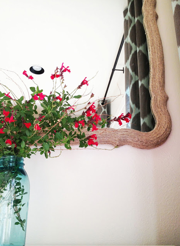 Textured mirror frame covered with rope DIY