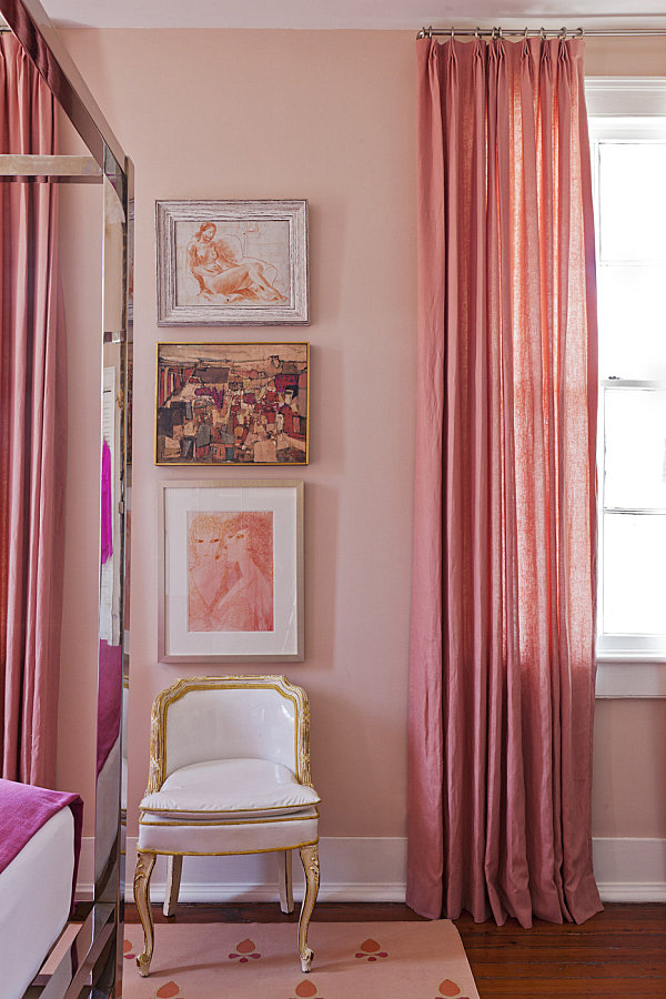 Trio of pictures in a pink bedroom