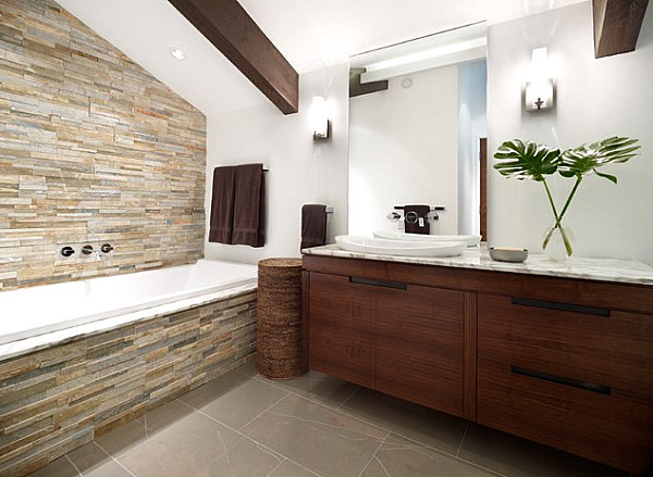 Tropical leaves in an earthy bathroom