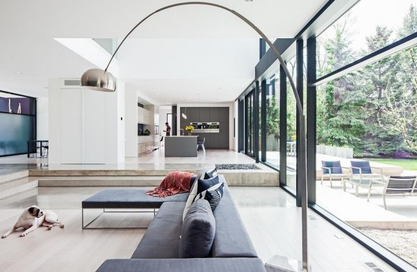 Uber modern family home with the Arco above the sectional couch