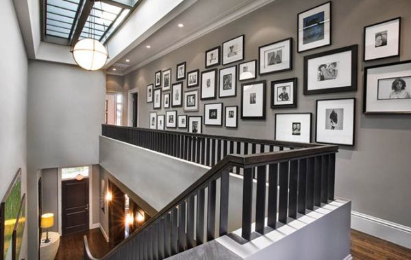 Wall next to the staircase is a popular spot for the display of photographs