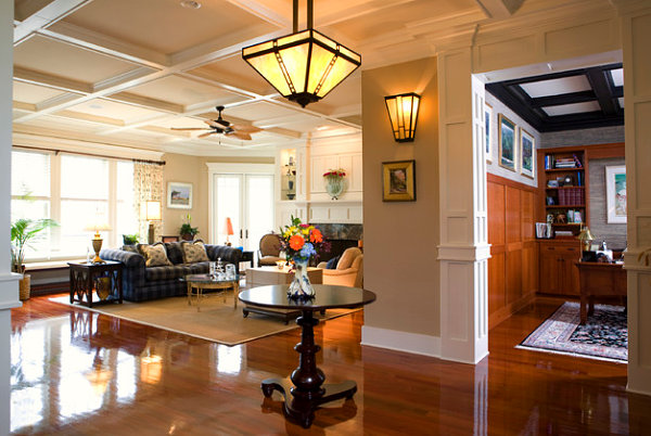 Warm lighting in a Craftsman-style entryway and family room
