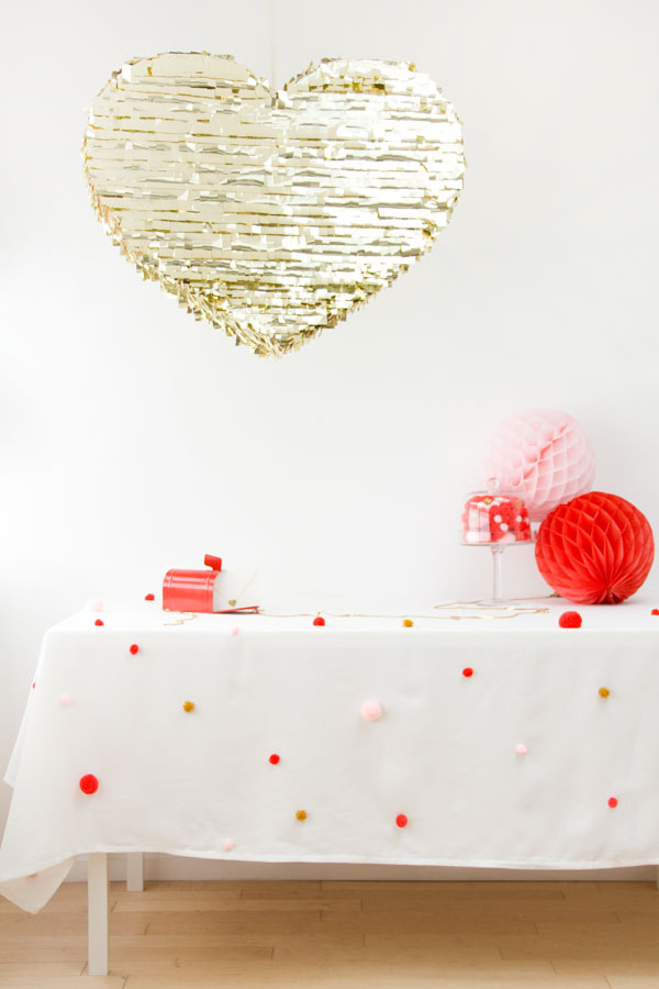 White table cloth with colorful pom poms