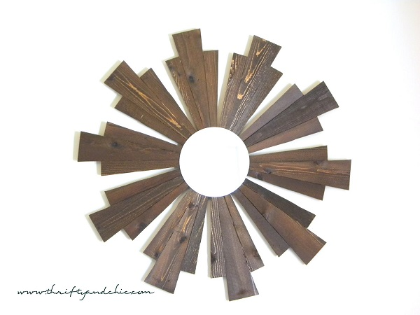 Wooden sunburst frame with circular mirror