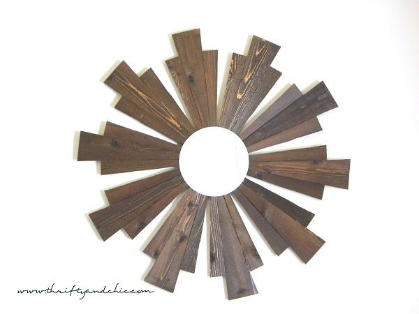 Wooden sunburst frame with circular mirror