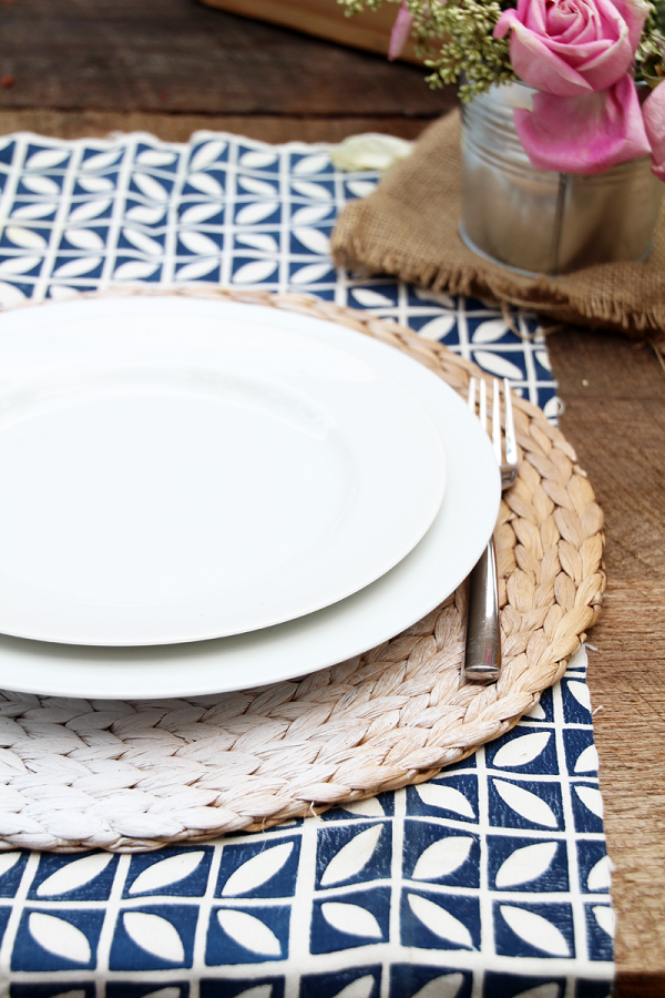 Woven circular placemat with ombre painting