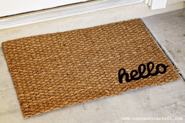 Woven welcome mat with hello stamp