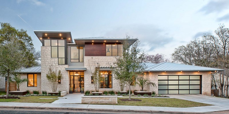 autin stone placqued villa Contemporary Texas Residence Combines Antique Touches With Cool Blue Accents