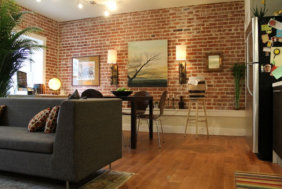 exposed brick walls in the living room