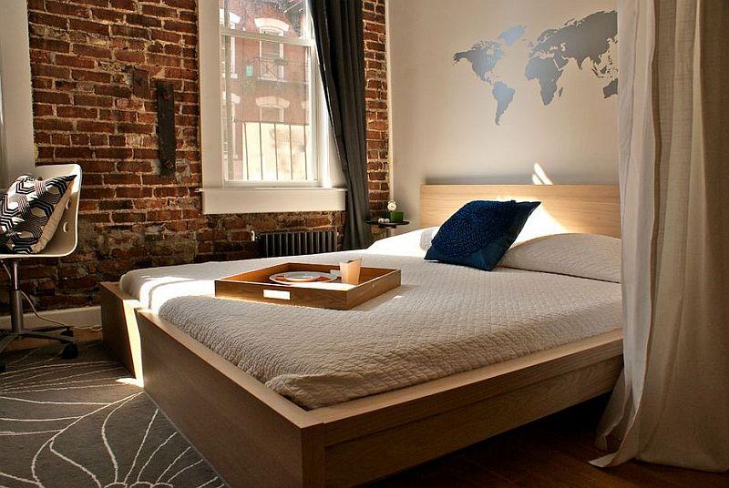 modern bedroom with exposed brick wall