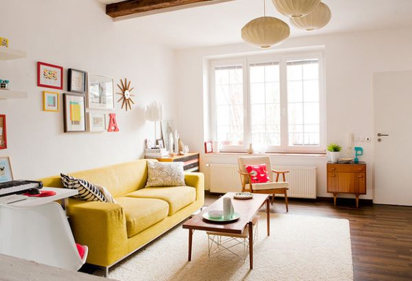 Accent couch in yellow adds warmth and freshness to a living room in white