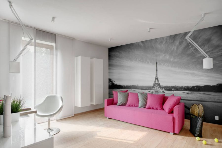 Accent couch with a mural of Paris behind it