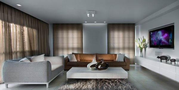An accent couch in brown adds sophisticated contrast