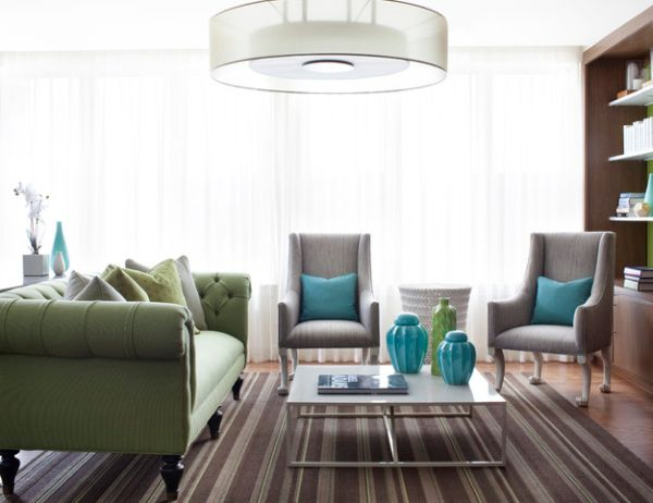 Aqua throw pillows combined effortlessly with green Chesterfield Sofa