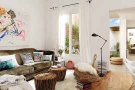 Artistic white living room with bursts of color