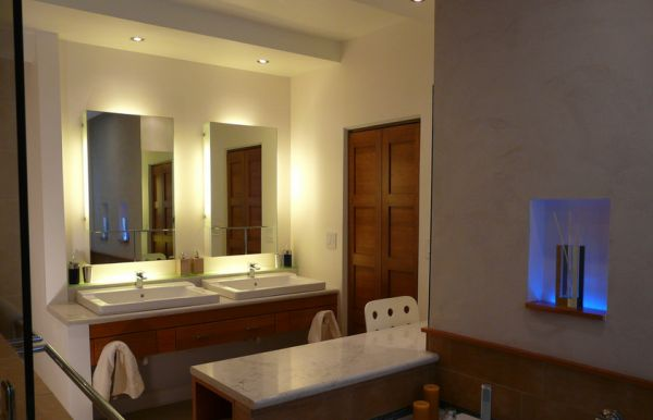 Backlit vanity mirrors look all the more beautiful with tiny recessed lights above