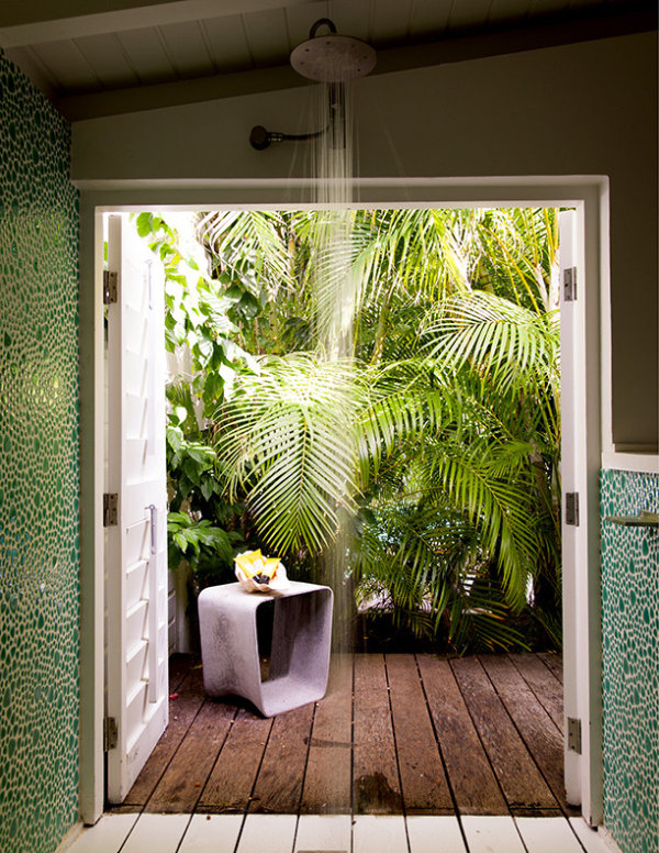Bathroom with a tropical garden view