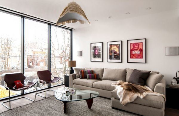 Beautiful contemporary living room with the Noguchi table and framed posters