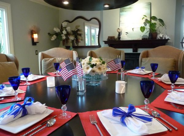 Beautiful glassware and an organized dining room with neatly placed flags