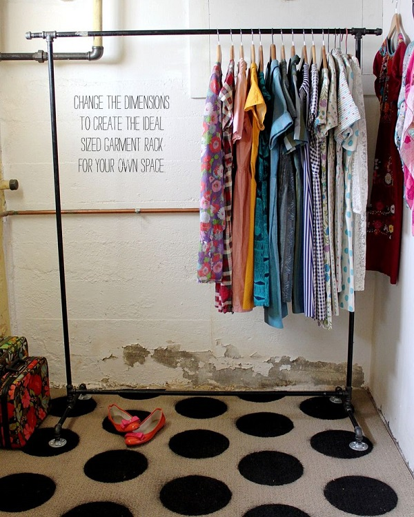 View in gallery Black steel pipe garment rack. Chic DIY Clothes Rack Ideas