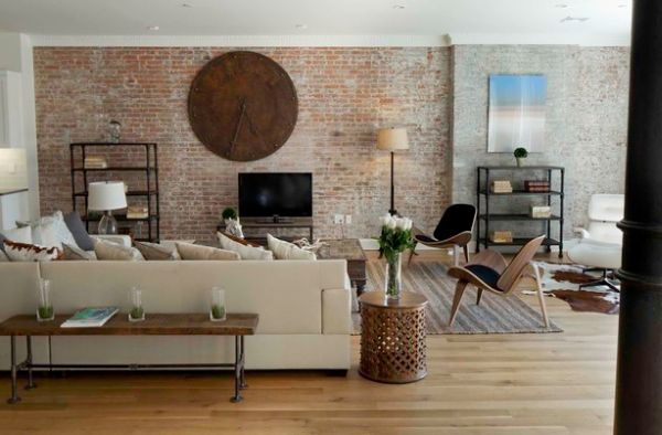Brick wall and unique clock give this eclectic space a distinct appeal