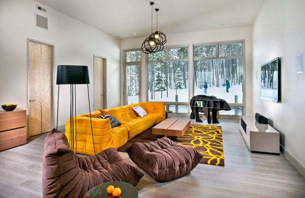 Bright accents of yellow brought in by the Togo Four Decades Of Luxury: Contemporary Inspirations Sporting The Iconic Togo Sofa