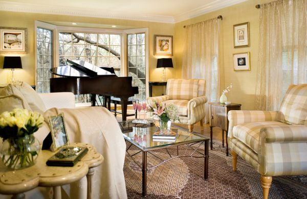 Bright and beautiful living room in golden yellows displays baby grande piano with style