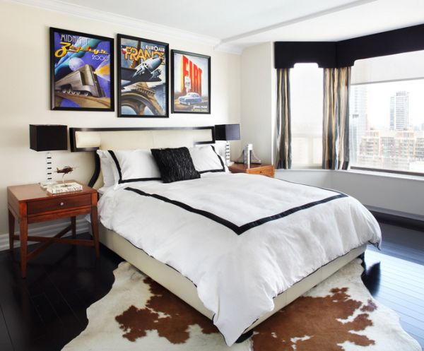 Bright posters add color to a chic contemporary bedroom in black and white