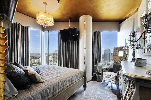 Ceiling with gold gives the bedroom a more spacious appeal