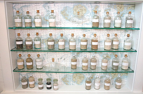Collection bottles against a wallpaper backdrop