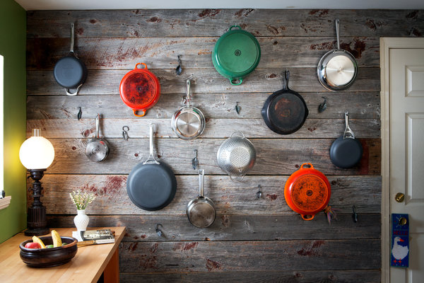 Colorful pots and pans as wall art
