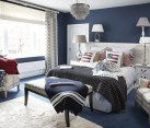 Combination of various patterns and prints in blue, white and red for a plush bedroom