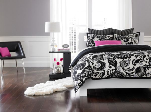 Contemporary bedroom in black and white with pink accents