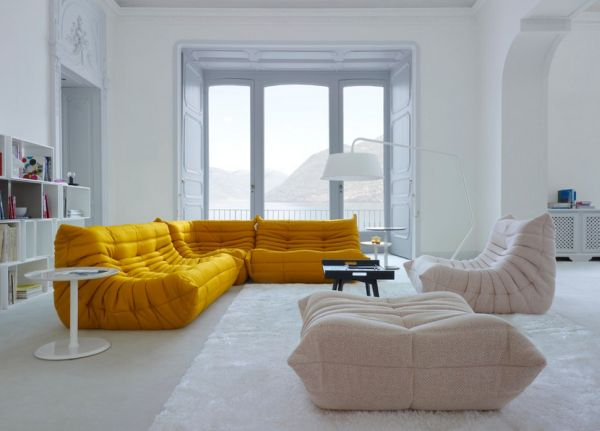 Contemporary living room in white with Togo adding yellow freshness!