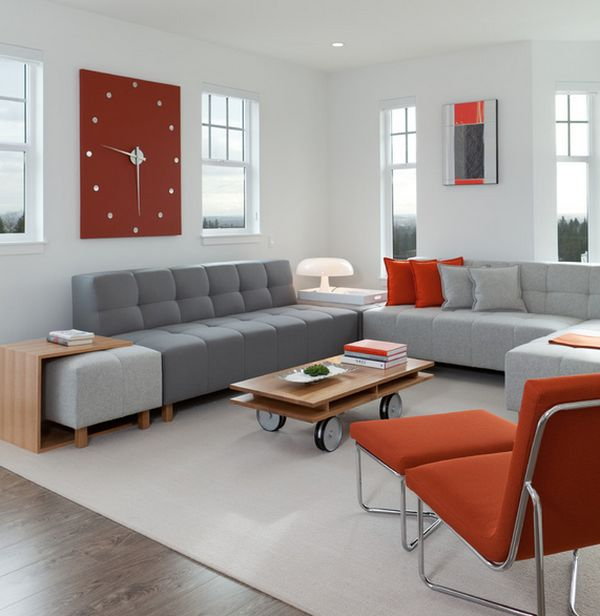 Contemporary living space with an exquisite wall clock that brings in reddish accents