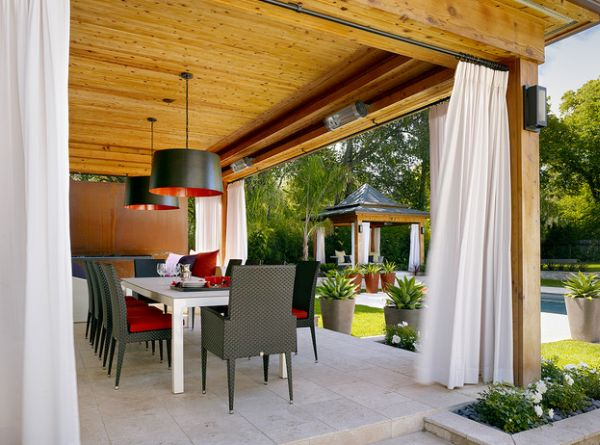 Contemporary patio showcases large drum pendants the fit into the color scheme effortlessly