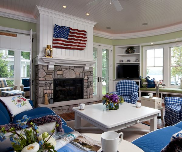 Cool blue cushions and white walls complement the flag above the fireplace elegantly