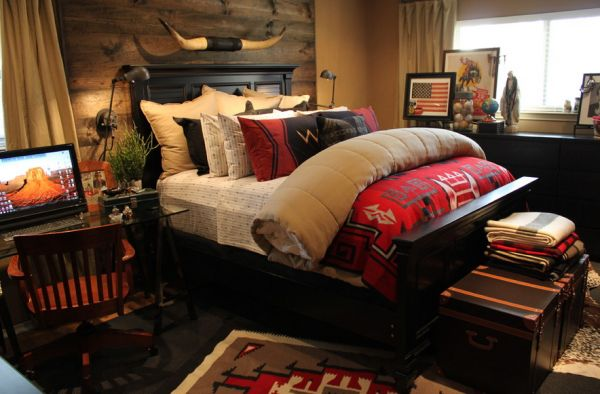 Cozy and relaxing bedroom uses deeper tones of red and blue