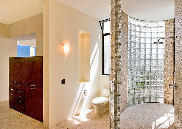 Curved shower space with glass block