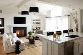Dark accents in the living space are enhanced using stylish drum lights