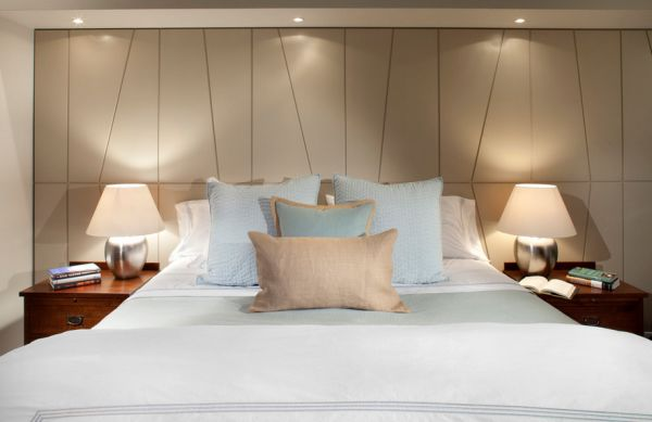 Dimmable recessed lights above the bed create a soothing atmosphere