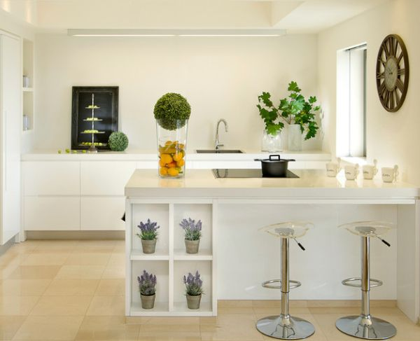 Displaying a wall clock above the kitchen counter seems to be a popular choice in modern homes